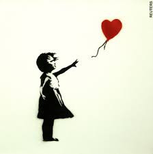 Letting go of a heart balloon