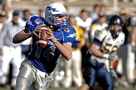 A football quarterback about to release the ball.