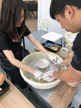 Girl made a bowl using the potter's wheel