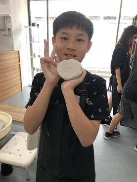 Boy enjoying his day at Urth&Phire pottery studio