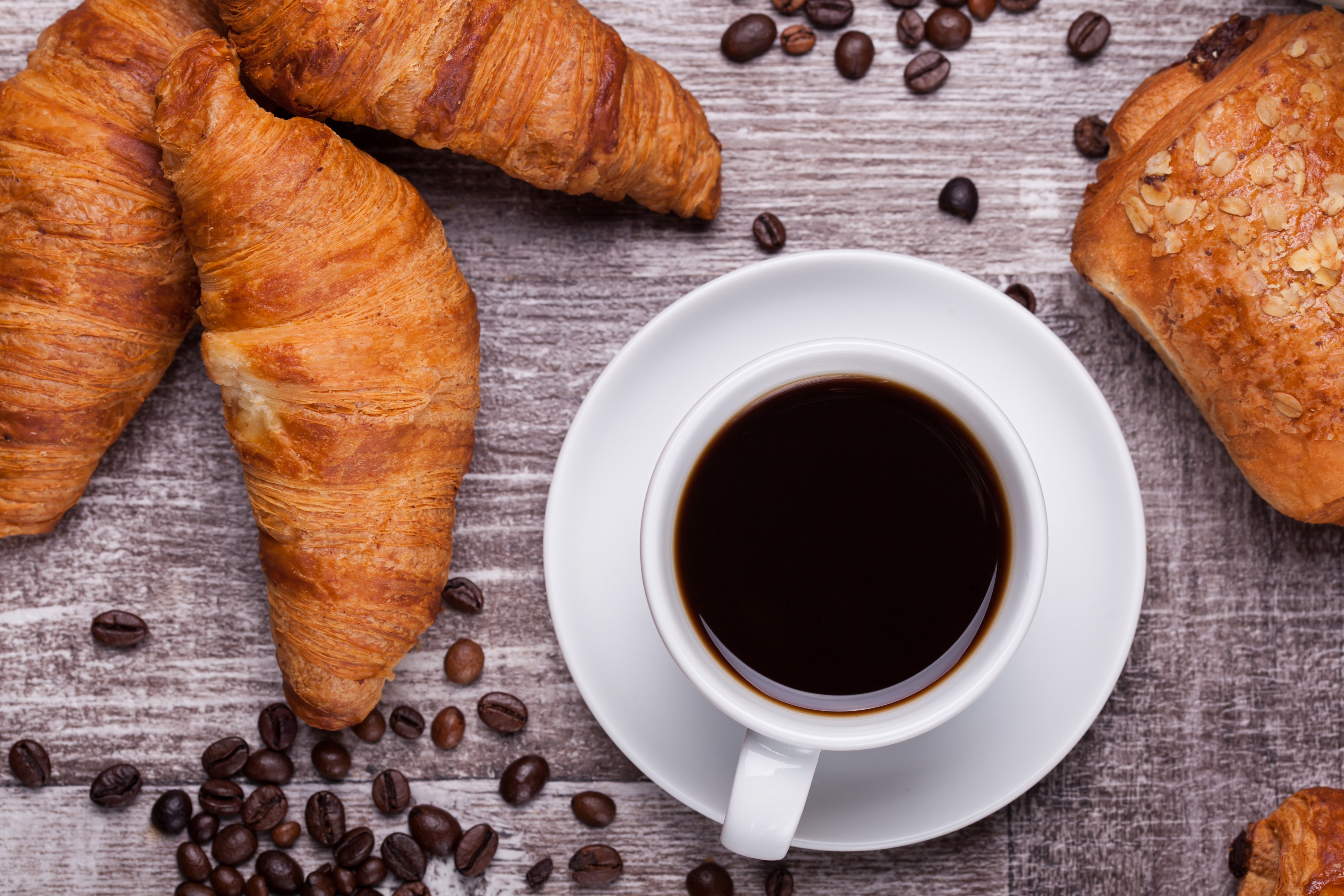 cup-of-hot-coffee-and-freshly-baked-croi