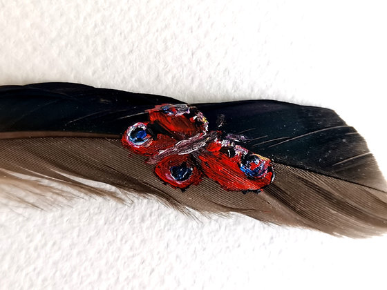 Peacock butterfly painted on a duck feather