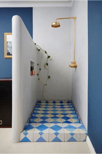Blue tiles in shower recess. Image Credit: Domino Magazine