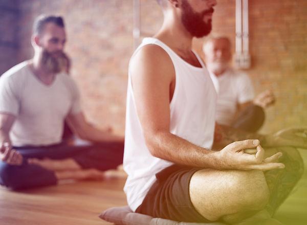 Men meditating gesture in a yoga class.jpg