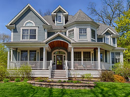 Wrap around front porch and turret in Glen Ellyn custom home