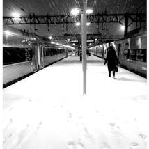 Woman on Snowy Platform
