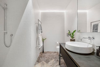 white cinca mosaic with silver travertine floor and slate bench.jpg