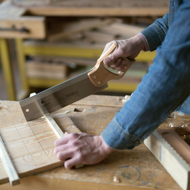 carpenter-cutting-wood