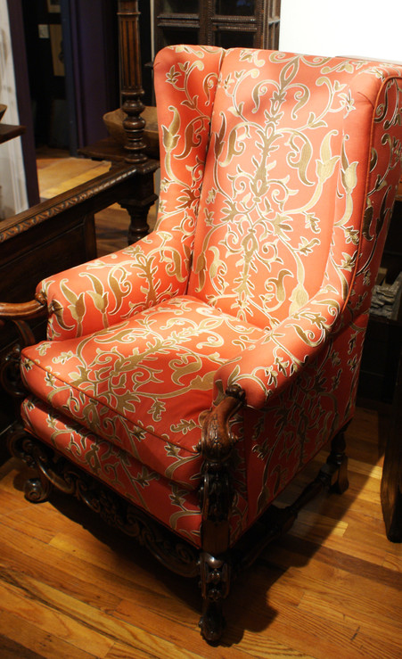 Late 19th Century English High Back Wing Chair with Hand Carved Walnut Arms, Supports, Skirt, and Legs