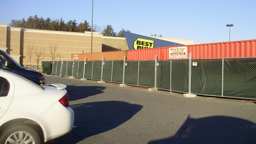 Temporary Fence Panels with Construction Screening on Blocks