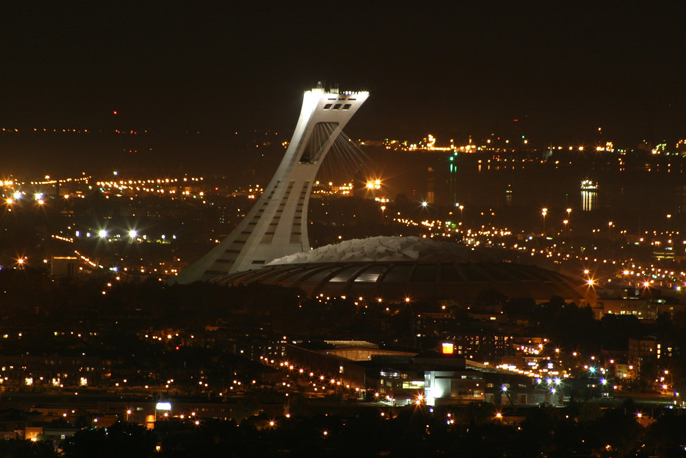 Olympic Stadium at night. Public Domain.