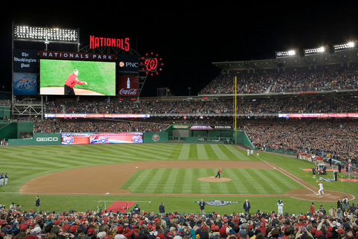 George W. Bush throws out the first pitch at a season opener at National Park. Public Domain.