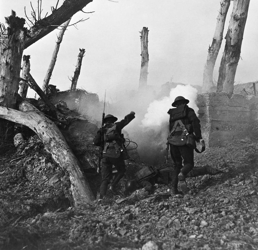 Two American soldiers run toward a bunker in World War I. Public Domain.