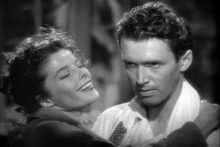 Hepburn and Jimmy Stewart in Philadelphia Story, Public Domain screenshot from the trailer, 1940.