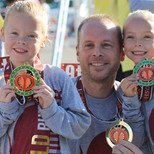 Kids with Dad and Medals.jpg