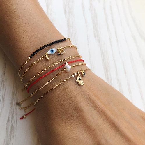 Kit de 5 pulseras / Oro laminado.