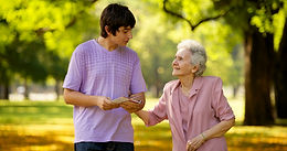 young-man-elderly-woman-visiting-1080937