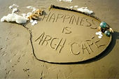 'Hapiness is Arch Cape' in the sand photograph