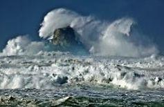 wave crashing ove Castle Rock off the Arch Cape coastline