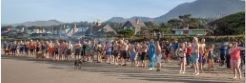 People lining up on the shoreline before entering te Pacific Ocean in the Polar Plunge
