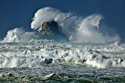 Crashing ocean waves over Castle Rock in the Pacific Ocean