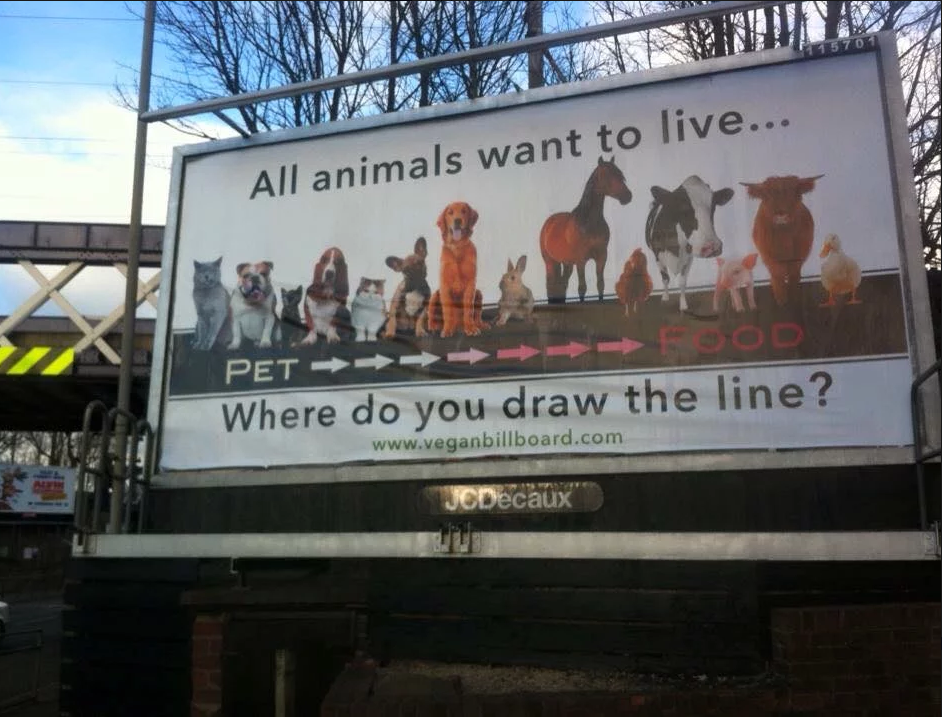 billboard featuring line of animals-'all animals want to live...where do you draw the line?'