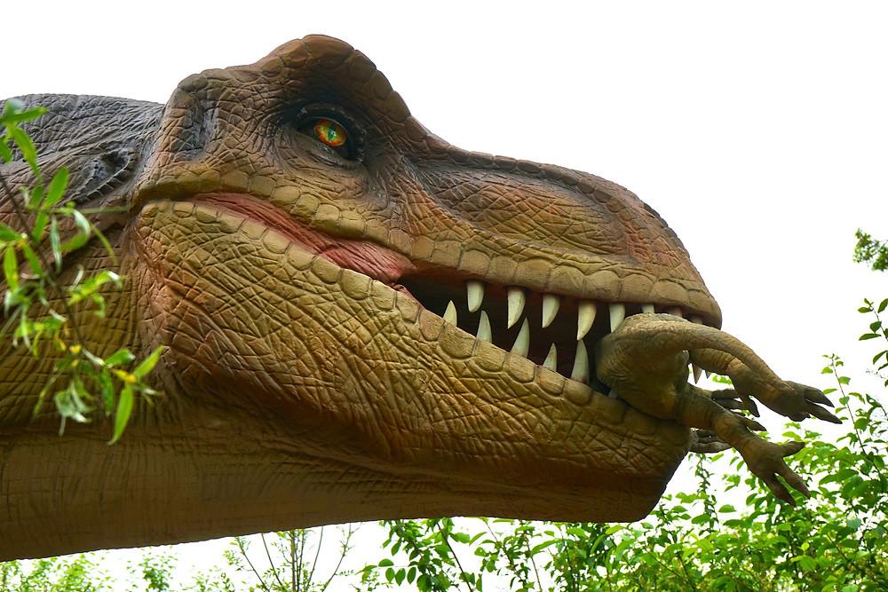 Sculpture of a carnivorous dinosaur eating a small dinosaur.