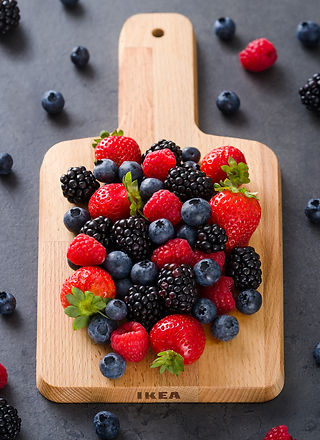 berries on wooden cutting board-Nupixe P