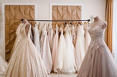 Assortment of dresses hanging on a hange