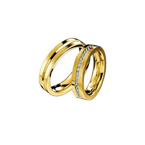 Elegáns sárgaarany jegygyűrűpár középen véséssel vagy gyémántokkal