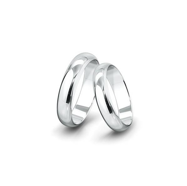 Belül lapos, kívül domborított felületű fehérarany jegygyűrűpár (5,5 mm)