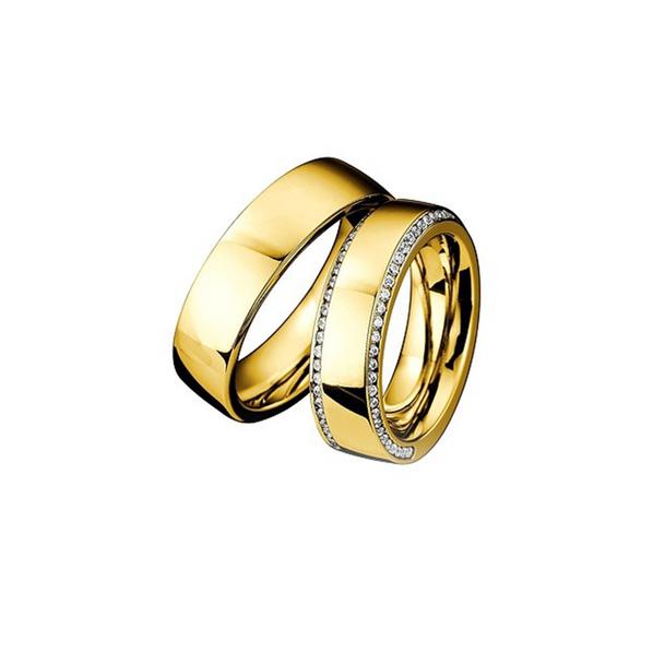 Sárgararany jegygyűrű két sorban gyémántokkal a női modellen