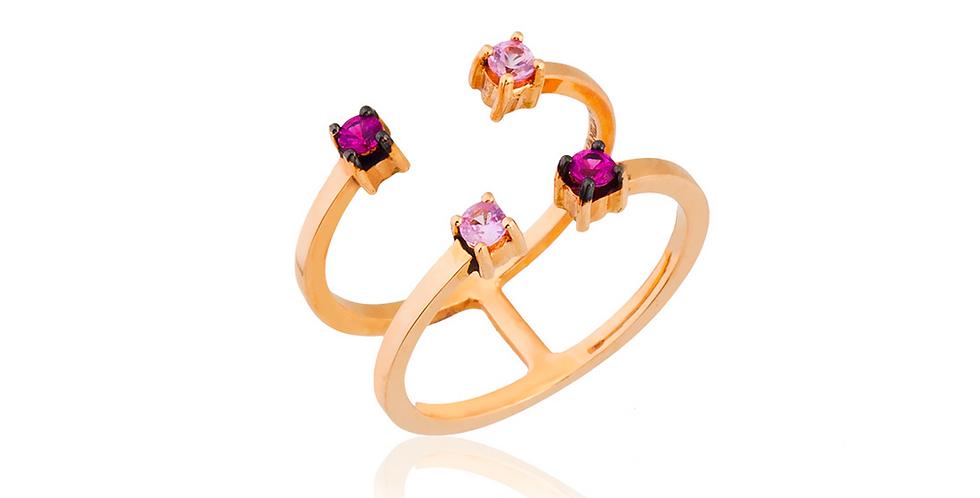 Rózsaarany, dupla sínes, nyitott gyűrű rózsaszínű zafírokkal ékesítve.