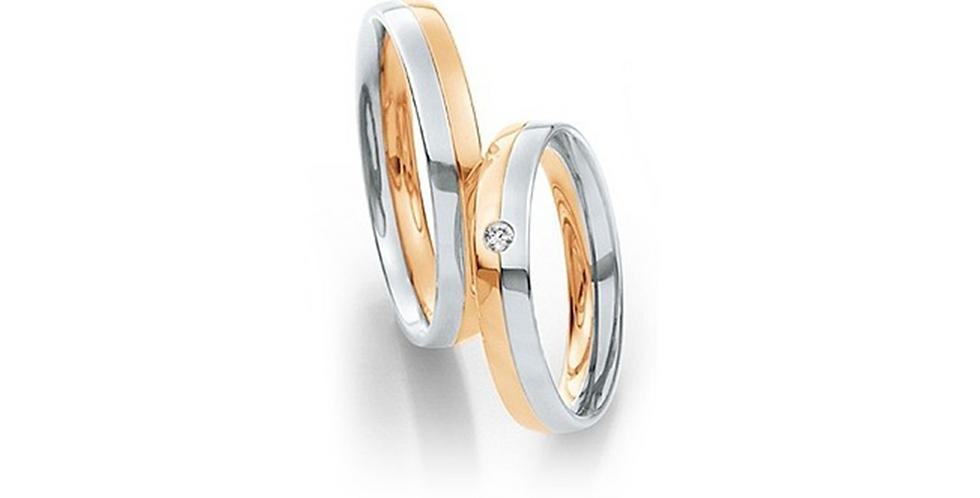 Lekerekített szélű fehér és rozéarany jegygyűrű középen véséssel és gyémánttal