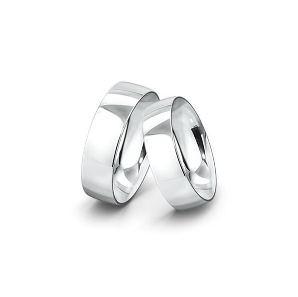 Kívül lapos, belül domborított felületű fehérarany jegygyűrűpár (7 mm)