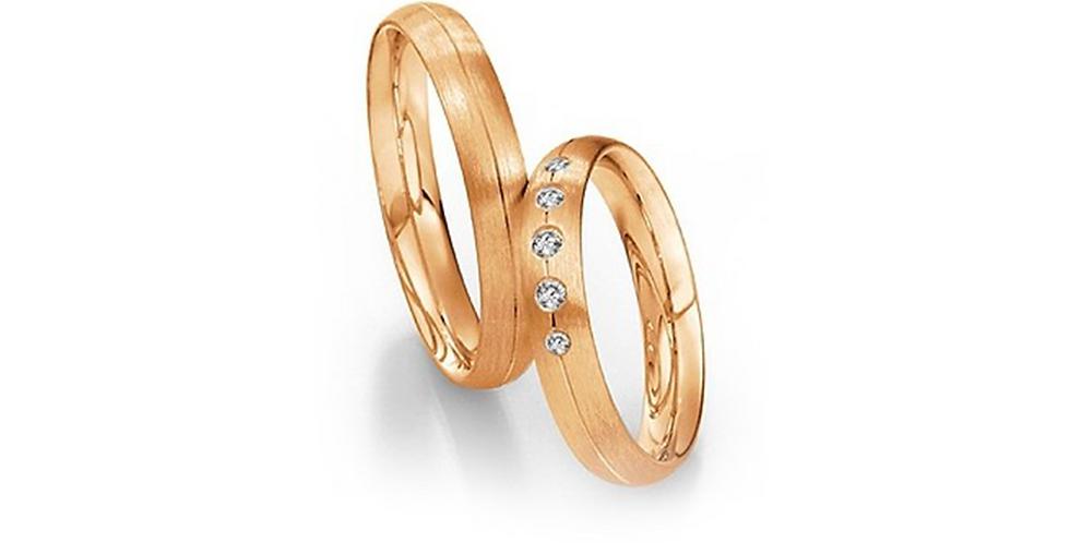 Domború felületű, középen vésett rozéarany jegygyűrűpár 5 gyémánttal