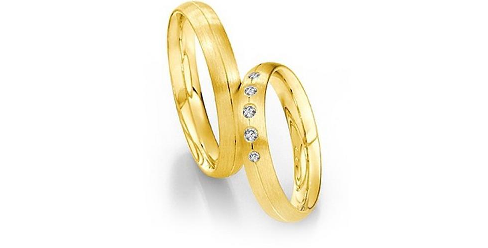 Domború felületű, középen vésett sárgaarany jegygyűrű 5 gyémánttal