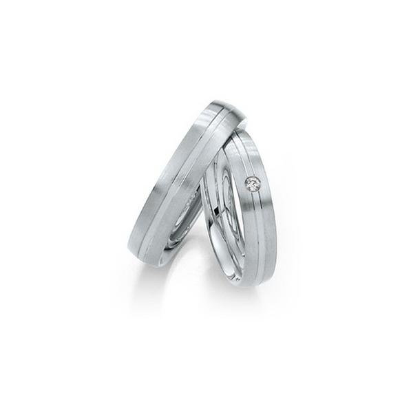 Fehérarany karikagyűrű középen fehérarany betéttel és gyémánttal