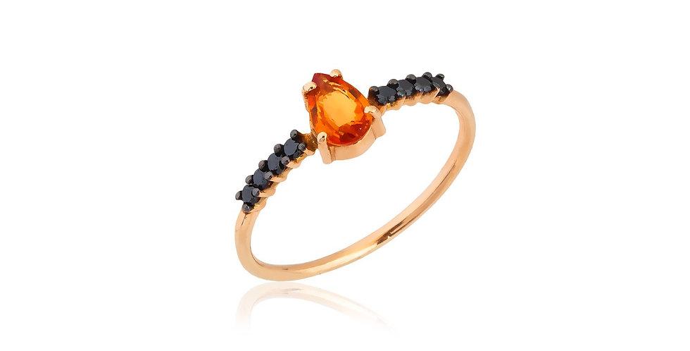 Rózsaarany gyűrű fekete gyémántokkal és csepp alakú narancssárga zafírral