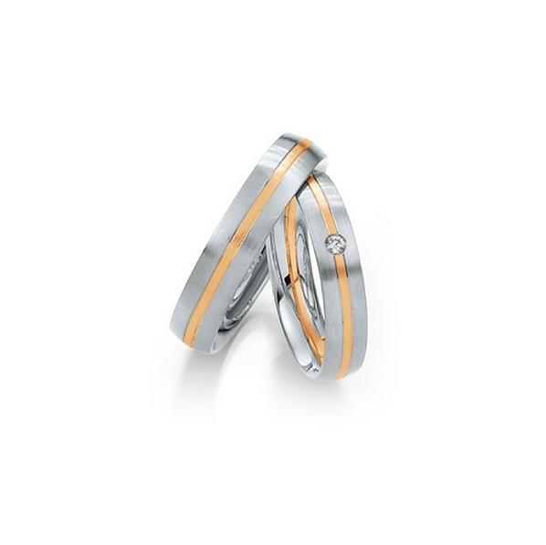 Fehérarany karikagyűrű középen rozéarany betéttel és gyémánttal