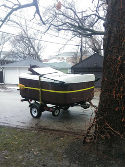 Hot tub strapped up on spa dolly