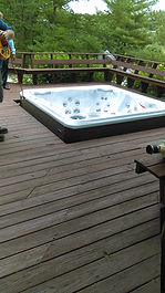 New hot tub placed in deck opening