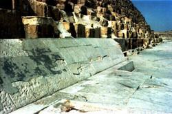 THE GREAT PYRAMID - Center of the north side. AT THE FRONT, INCLINED STONE CASING BLOKS WHICH FORMED
