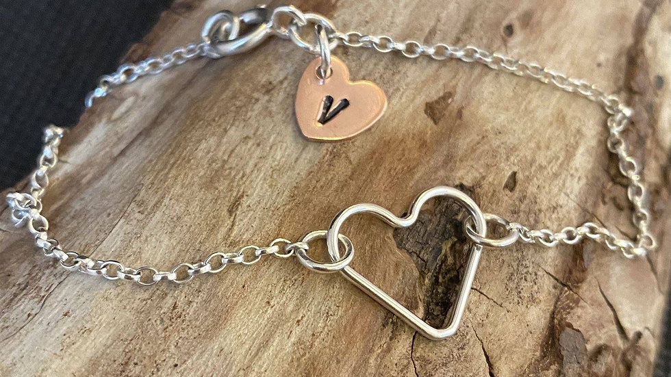 Silver heart bracelet with personalised copper heart
