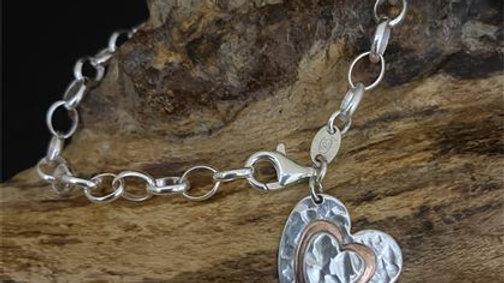 Silver & Copper heart on a sterling silver bracelet