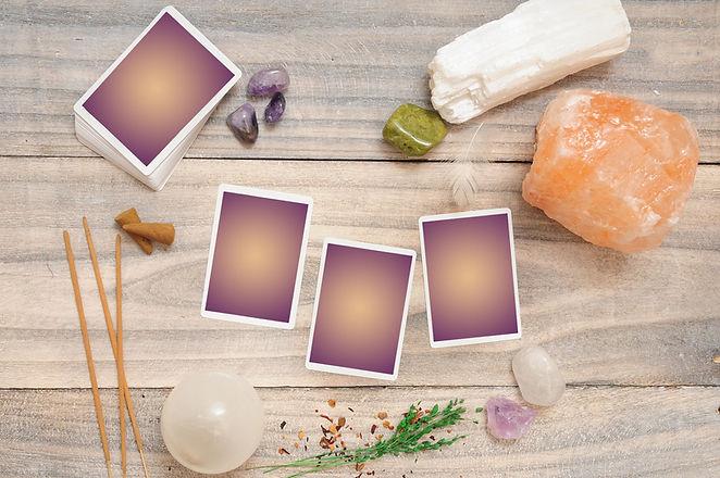 Tarot card reading layout, wood backgrou