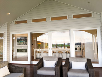 Sliding timber doors with fixed glass above