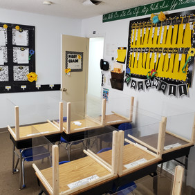 elementary class with desk partitians