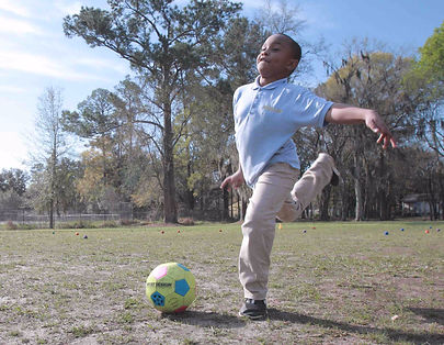 Young%20Child%20Kicking%20Soccer%20Ball_