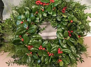 Beautiful handmade wreath with holly